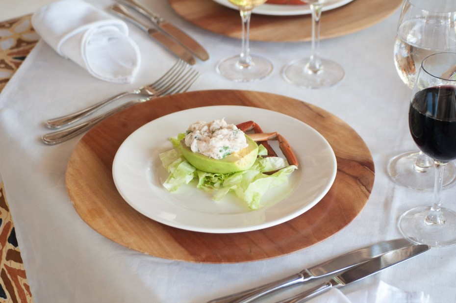 Stuffed avocado served with a mix of crab, celery, mayonnaise and lime juice