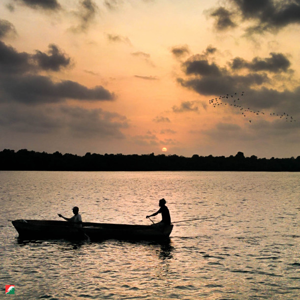 Fishermen at Mida Creek at sunset