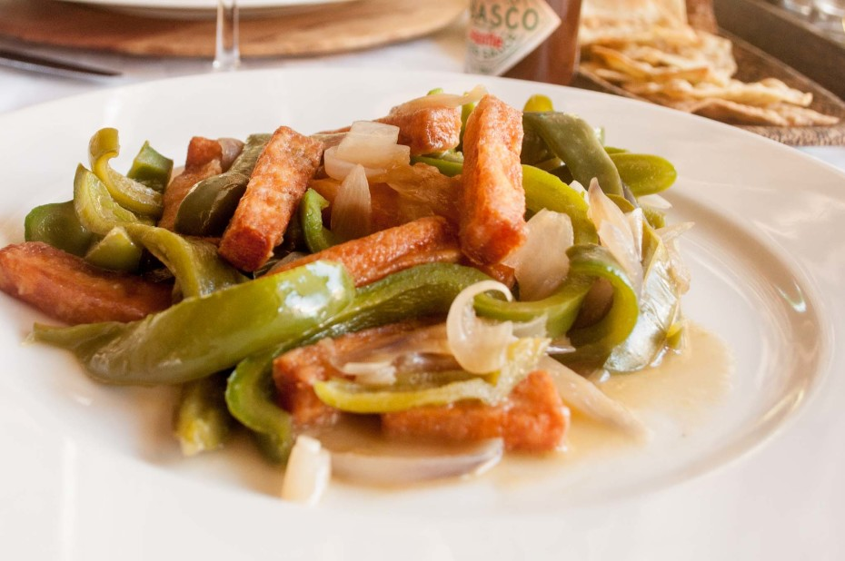 Paneer with vegetables. Paneer (cheese sticks), floured and stir fried, served with green peppers and onions