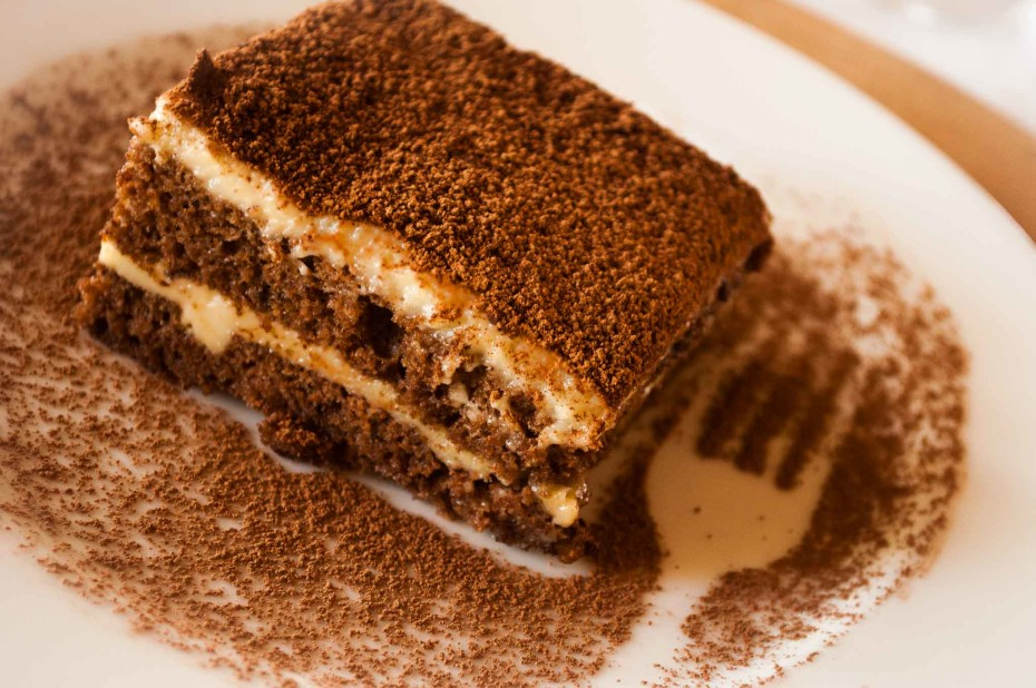 Tiramisu Kenyan style. Layers of sponge cake wet with coffee, alternated with pastry cream and dusted with cocoa