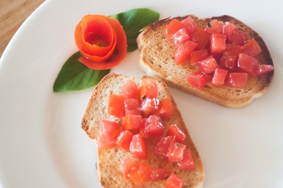 Traditional bruschetta. Toasted homemade bread slices served with tomato cubes marinated in olive oil and oregano
