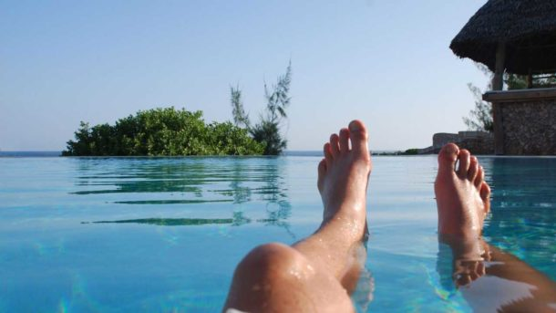 A guest laying in the Lonno Lodge swimming pool