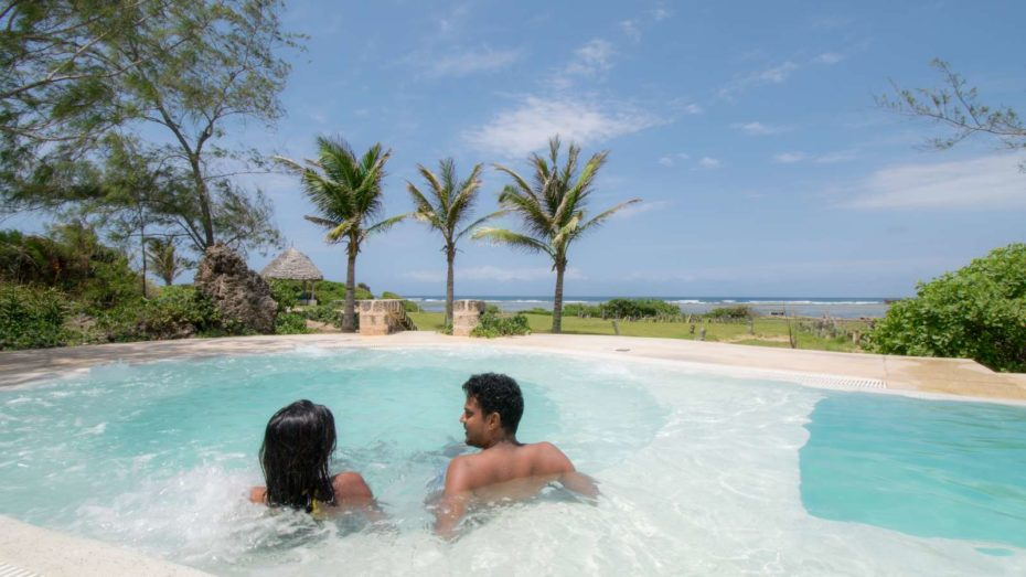 Guests in Jacuzzi beside the swimming pool